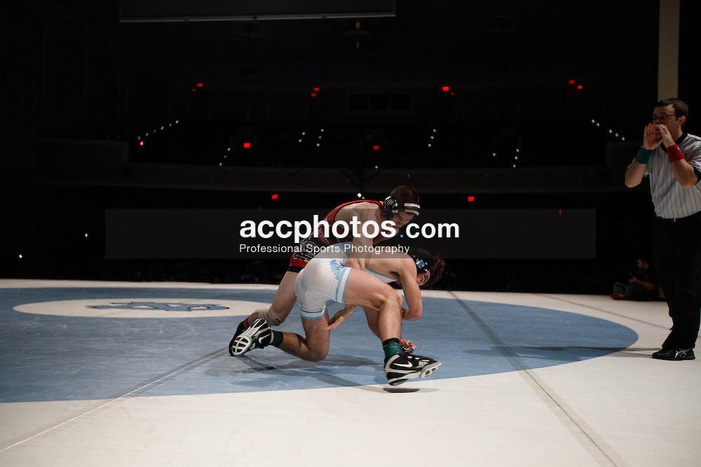 2017 January 23: North Carolina Tar Heels during a match against the North Carolina State Wolfpack at Memorial Hall in Chapel Hill, NC. NCSU won 19-11.<br /> <br /> 125: Sean Fausz (NCSU) maj. dec. James Szymanski (UNC), 12-3