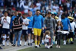 Tottenham Hotspur goalkeeper Hugo Lloris (centre) leads the team on a lap of appreciation