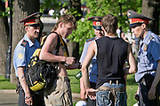 Moscow, Russia, 20/05/2007..Police arrest youths drinking in Alexandrovsky Gardens by Red Square near the Kremlin during a heatwave.