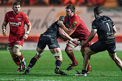 Scarlets' David Bulbring is tackled by Ospreys' Dan Lydiate - Mandatory by-line: Craig Thomas/Replay images - 26/12/2017 - RUGBY - Parc y Scarlets - Llanelli, Wales - Scarlets v Ospreys - Guinness Pro 14