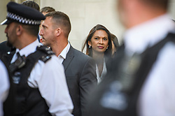 © Licensed to London News Pictures. 19/09/2019. London, UK. Businesswoman GINA MILLER is seen flanked by police and security as she leaves The Supreme Court in London at the end of day three of an appeal against a judicial review of Boris Johnson's suspension of Parliament. The case has been brought by remain campaigner Gina Miller, with support from former British Prime Minister John Major. Photo credit: Ben Cawthra/LNP