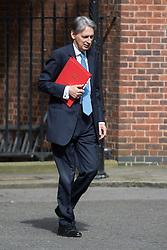Foreign Secretary Philip Hammond arrives at Prime Minister David Cameron's final cabinet meeting following Theresa May's anticipated takeover as Leader of the Conservative Party and Prime Minister
