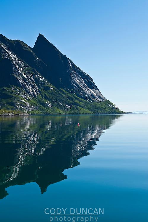 Mountain reflection in Kjerkfjord, Reine, Lofoten islands, Norway