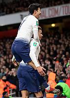 Football - 2018 / 2019 EFL Carabao Cup (League Cup) - Quarter-Final: Arsenal vs. Tottenham Hotspur<br /> <br /> Heung-Min Son (Tottenham FC)  leaps onto the shoulders of  goalscorer Dele Alli (Tottenham FC) at The Emirates.<br /> <br /> COLORSPORT/DANIEL BEARHAM