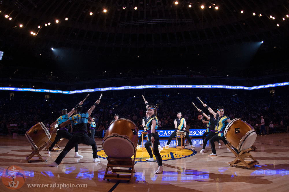 November 17, 2015; Oakland, CA, USA; San Jose Taiko drummer Allison Ishida performs during halftime of an NBA basketball game between the Golden State Warriors and the Toronto Raptors at Oracle Arena. The Warriors defeated the Raptors 115-110.