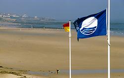 Clean beach with blue EC flag; Tynemouth Longsands; North Tyneside; NE England UK