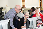 """14/10/2014 14/10/2014 Bredan """"Speedie"""" Smith   teaching coding all over Galway including retired Galway teachers  Anne Newell and Eileen Treacy at the Galway Education centre learning coding during the EU CODE WEEK. Photo:Andrew Downes a"""