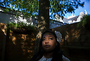 """Nadia Lee stands in what is nicknamed the """"garden of Eden"""" at the Eden House in New Orleans. (Photo by Chris Granger, NOLA.com 