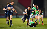 Sale Sharks wing Denny Solomona offloads the ball to centre Sam James during a Gallagher Premiership match won by Sale Sharks 27-17 at the AJ Bell Stadium, Eccles, Greater Manchester, United Kingdom, Friday, April 5, 2019. (Steve Flynn/Image of Sport)
