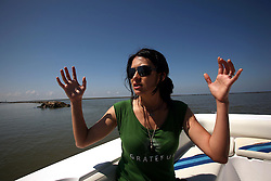 05 May 2010. Venice, Louisiana. Deepwater Horizon, British Petroleum environmental oil spill disaster.<br /> ARCA NASCAR rising motor racing star and environmental activist Leilani Munter takes in the floating oil containment booms laid out in the ecologically sensitive marshes <br /> of the Gulf of Mexico. She is stunned by the enormity of the oil slick.<br /> Photo credit; Charlie Varley/varleypix.com