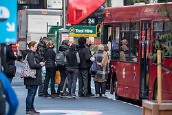 © Licensed to London News Pictures. 13/10/2020. London, UK. Office workers queue at a bus stop in Westminster, London today as the Office for National Statistics figures reveal unemployment rises by a further 138,000 as fears grow many more will be on the dole by the end of the year. Yesterday Prime Minister Boris Johnson addressed the Nation to announce a new three tier lockdown system for the country as increasing levels of coronavirus infections continue to rise in the UK. Photo credit: Alex Lentati/LNP