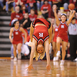 Feb 21, 2009; Piscataway, NJ, USA; A Rutgers cheerleader does a backflip during a timeout in the first half of Rutgers' 55-42 victory over Providence at the Louis Brown Athletic Center.