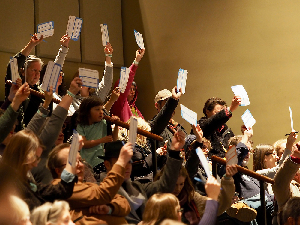 Fairfield Iowa caucus attendees hold up their first round Presidential Preference cards to be counted in order to determine if their candidate is viable. A viable candidate is one that receives the support of 15% of the people in the room and moves on to the next round of voting.
