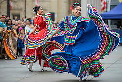 © Licensed to London News Pictures. 30/12/2018. London, UK. Two dancers from Carnaval Del Pueblo, a dance group from across Latin America, perform at a preview ahead of the London New Year's Day Parade in Trafalgar Square. More than 8,000 performers from 26 countries will take part in the parade on 1st January 2019. Photo credit: Rob Pinney/LNP