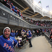 New York Rangers fans celebrate a goal for their team during the New York Rangers Vs New Jersey Devils NHL regular season game held outdoors at Yankee Stadium. New York Rangers won the game 7-3. Yankee Stadium, The Bronx, New York, USA. 26th January 2014. Photo Tim Clayton