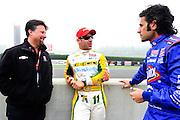 30 March - 1 April, 2012, Birmingham, Alabama USA.Michael Andretti, Tony Kanaan and Dario Franchitti chat before first practice. .(c)2012, Jamey Price.LAT Photo USA