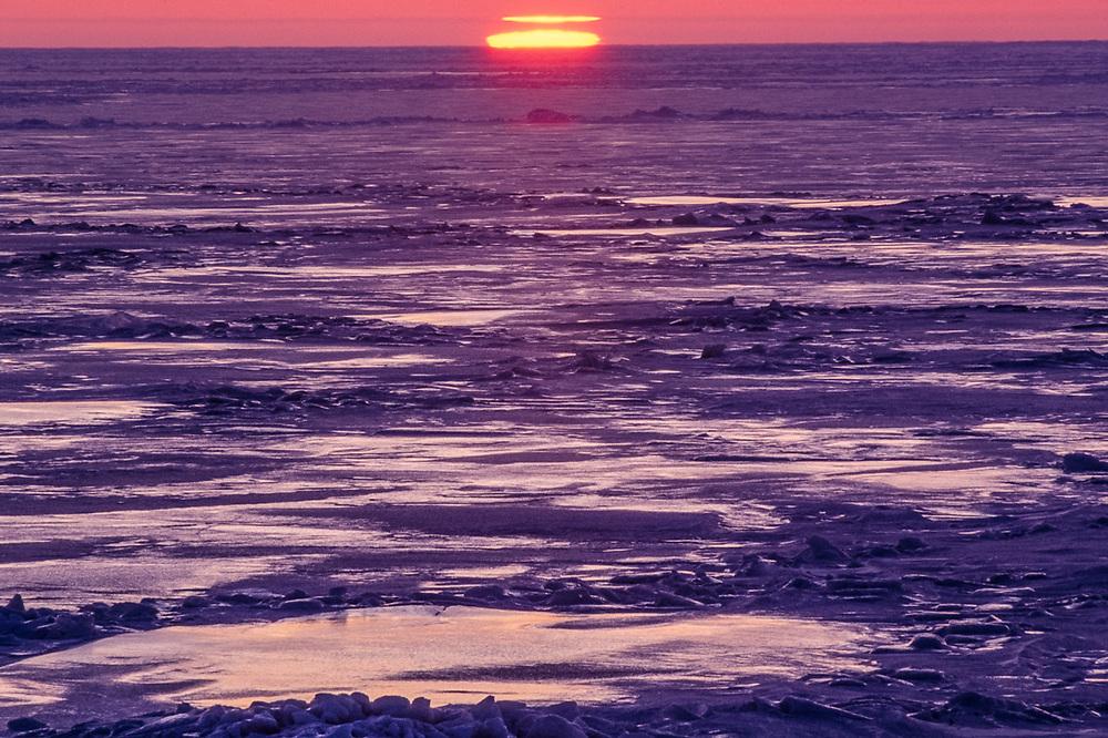 Sunset over the frozen Chukchi Sea, April, Cape Krusenstern National Monument, Alaska, USA