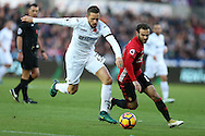 Gylfi Sigurdsson of Swansea city (l) goes past Juan Mata of Manchester Utd. Premier league match, Swansea city v Manchester Utd at the Liberty Stadium in Swansea, South Wales on Sunday 6th November 2016.<br /> pic by  Andrew Orchard, Andrew Orchard sports photography.