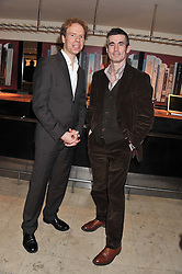 Left to right, 2011 Costa Book Awards finalists MATTHEW HOLLIS and ANDREW MILLER at the 2011 Costa Book Awards held at Quaglino's, 16 Bury Street, London on 24th January 2012.