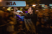 "New York, NY, October 31, 2013. A man aims a prop spy camera labeled ""NSA"" at the crowd in the Greenwich Village Halloween Parade."