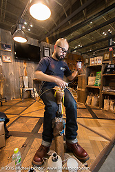 Boot-making demonstration at the White's Boots booth at the Mooneyes Yokohama Hot Rod & Custom Show. Yokohama, Japan. December 6, 2015.  Photography ©2015 Michael Lichter.