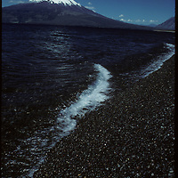 Volcan Osorno rises over Lake Llanquihue in the Lakes Distric of Chile.