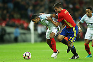 Theo Walcott of England is challenged by Cesar Azpilicueta of Spain. England v Spain, Football international friendly at Wembley Stadium in London on Tuesday 15th November 2016.<br /> pic by John Patrick Fletcher, Andrew Orchard sports photography.