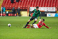 Rochdale's Aaron Morley is tackled by Charlton's Alfie Doughty during the EFL Sky Bet League 1 match between Charlton Athletic and Rochdale at The Valley, London, England on 12 January 2021.