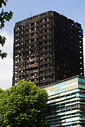 View of the burned out Grenfell Tower  June 16th 2017, London, United Kingdom. Grenfell Tower burned out after a catastophic fire killing more than 58 people. The tower caught fire early Wednesday morning and final casualty figueres may end up to be many more with police not expecting to be able to find and recover all bodies and to find all missing people. No fire sprinkler in place and cheap cladding made with plastic is so far blamed for the ferocious fire.