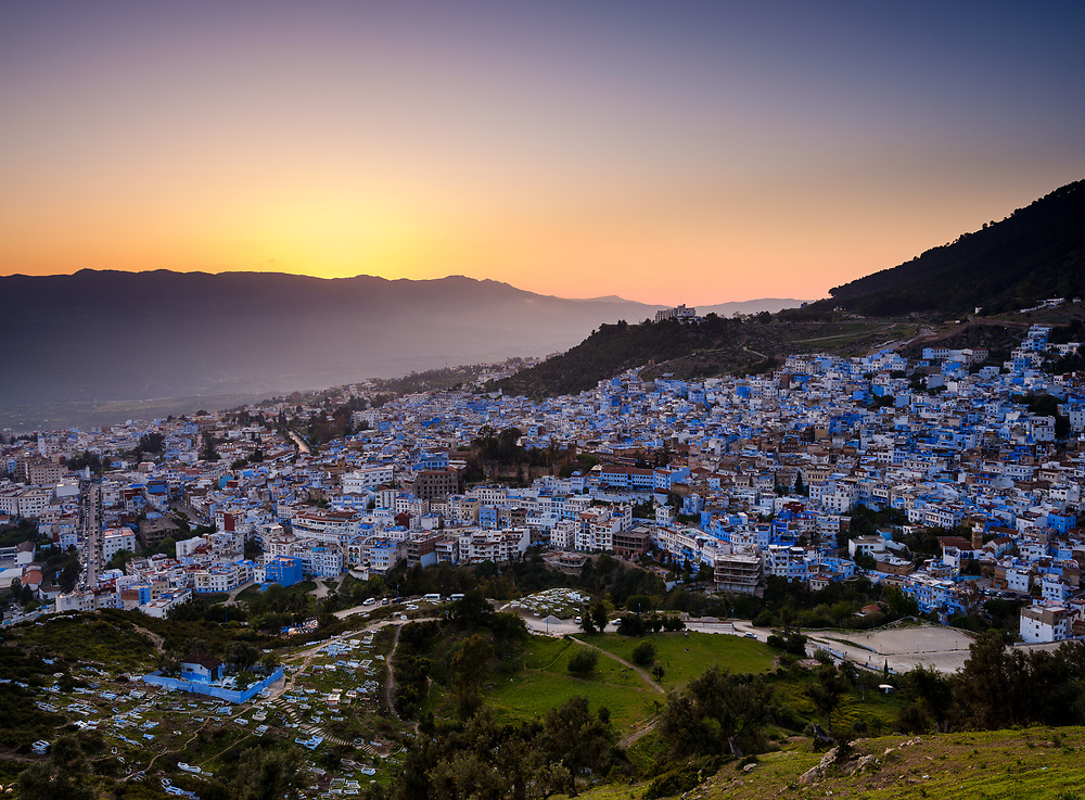 CHEFCHAOUEN, MOROCCO - CIRCA MAY 2018: Panoramic view of Chefchaouen and the Rif mountains at sunset.