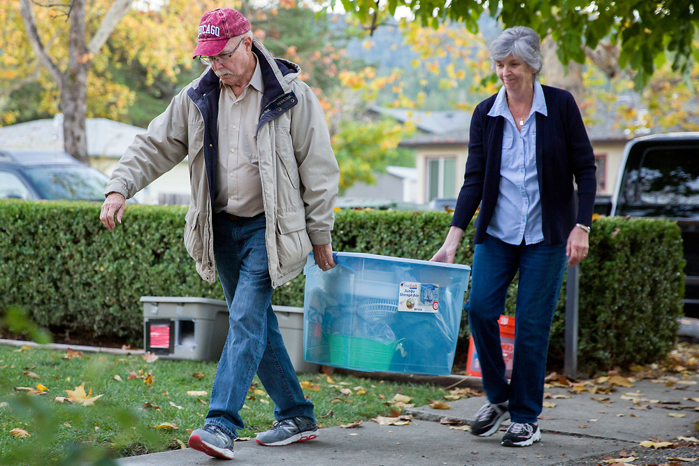 From left: Michelle Hickman's in-laws Dan and Donna Hickman help her move into her new home on Friday, Nov. 17, 2017, in Calistoga, Calif. Michelle Hickman and their family were burned out of their rental home by the Tubbs Fire. The Chronicle's Season of Sharing helped them rent a new place in Calistoga.