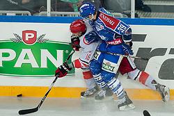 Matt Siddall (KHL Medvescak Zagreb, #39) vs Miha Brus (HK Acroni Jesenice, #16) during ice-hockey match between KHL Medvescak Zagreb and HK Acroni Jesenice in 39th Round of EBEL league, on Januar 8, 2012 at Arena Zagreb, Zagreb, Croatia. (Photo By Matic Klansek Velej / Sportida)