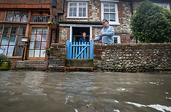 © Licensed to London News Pictures. 10/02/2020. Bosham, UK. Residents look out at rising high tide flood water in Bosham, West Sussex as the effects of storm Ciara are still being felt in parts of the UK. Photo credit: Peter Macdiarmid/LNP