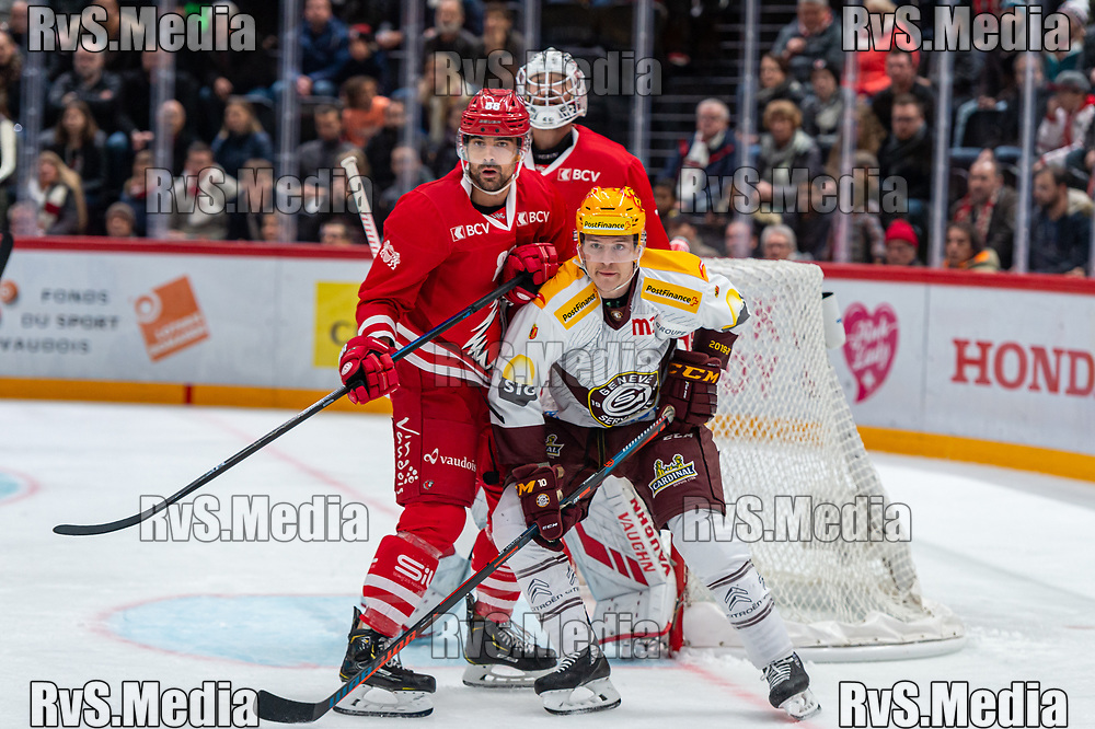 LAUSANNE, SWITZERLAND - NOVEMBER 23: #10 Tommy Wingels of Geneve-Servette HC and #88 Matteo Nodari of Lausanne HC in action during the Swiss National League game between Lausanne HC and Geneve-Servette HC at Vaudoise Arena on November 23, 2019 in Lausanne, Switzerland. (Photo by Monika Majer/RvS.Media)