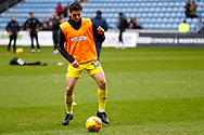 Wimbledon defender Tyler Garrett (12), on loan from Doncaster Rovers, warming up  during the EFL Sky Bet League 1 match between Coventry City and AFC Wimbledon at the Ricoh Arena, Coventry, England on 12 January 2019.