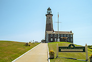 The Montauk Point Light is a lighthouse located adjacent to Montauk Point State Park, at the easternmost point of Long Island, in the hamlet of Montauk in the Town of East Hampton in Suffolk County, New York. The lighthouse was the first to be built within the state of New York, and was the first public works project of the new United States. It is the fourth oldest active lighthouse in the United States