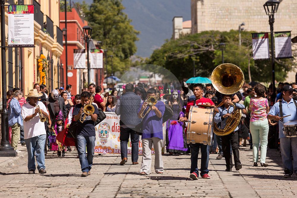 A Mexican brass band leads a procession for the Day of the Dead festival known in spanish as Día de Muertos in Oaxaca, Mexico. The festival celebrates the lives of those that died.