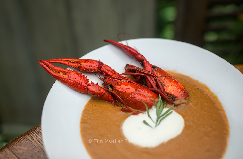 A bowl of crawfish bisque is part of the Northshore cuisine from Palmettos on the Bayou. Palmettos on the Bayou is located in Slidell, Louisiana and the restaurant includes a 75-foot dock with tables overlooking Bayou Bonfouca.