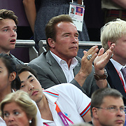 Arnold Schwarzenegger and the Mayor of London Boris Johnson watching action during the Men's Basketball Final between USA and Spain at the North Greenwich Arena during the London 2012 Olympic games. London, UK. 12th August 2012. Photo Tim Clayton