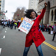 A jubilant demonstrator at the end of the Women's March in Oakland, CA, January 21, 2017. An estimated 60,000 people participated in the Oakland March, double the anticipated number. Throughout the country and the world people marched in solidarity for women's rights and humanitarian rights.