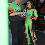 Sprint Cup Series driver Danica Patrick (10) speaks to a crew member in the garage area during the 57th Annual NASCAR Coke Zero 400 race first practice session at Daytona International Speedway on Friday, July 3, 2015 in Daytona Beach, Florida.  (AP Photo/Alex Menendez)