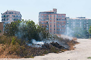 A small fire start to burns an area close to the houses on August 03, 2017 in Crotone, Italy. An intense heatwave is sweeping across many regions of Italy, prompting local councils to issue a number of high level alerts. An intense heatwave is sweeping across many regions of Italy, prompting local councils to issue a number of high level alerts. The province of Crotone has suffered much damage due to the fires over the last few weeks. ©Simone Padovani