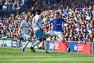 Portsmouth Midfielder, Ronan Curtis (11) beats Coventry City Defender, Dujon Sterling (17) to the ball during the EFL Sky Bet League 1 match between Portsmouth and Coventry City at Fratton Park, Portsmouth, England on 22 April 2019.