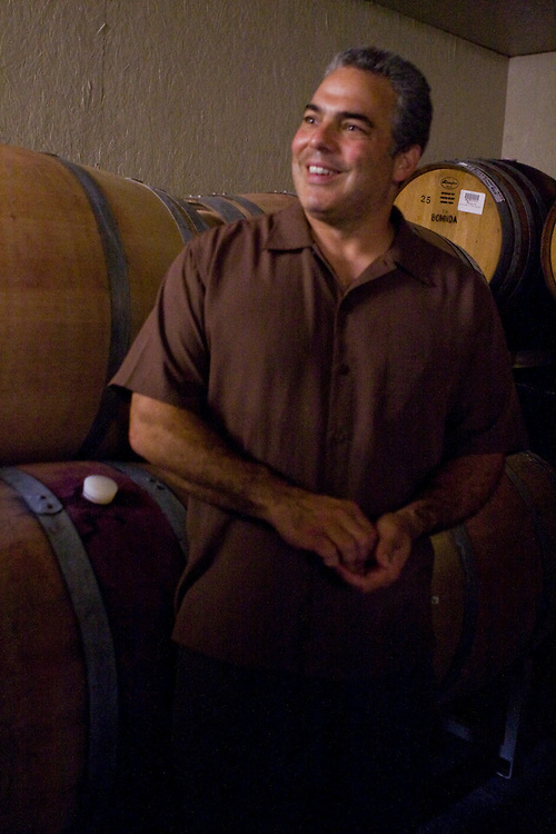 Franz, one of the two persone winemaking team of Montfair Vineyards shows the barrel room of Mountfair.