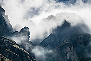 Hike the dramatic Sentier des Chamois from Verbier, in Switzerland, the Alps, Europe. The Chamois Path starts at La Chaux ski lift and ends at Fionnay PostBus. Cross Col Termin (2648m/8688 ft) in Haut Val de Bagnes nature reserve and descend to Lake Louvie via 1800s stone barns to the north, then to Fionnay (640 m up, 1415 m down in 8.5 hours). Along the way, we admired a group fighting of Hérens cows, ibex with huge horns, and the glaciers of Grand Combins. Optionally stay overnight in dorms Cabane de Louvie.