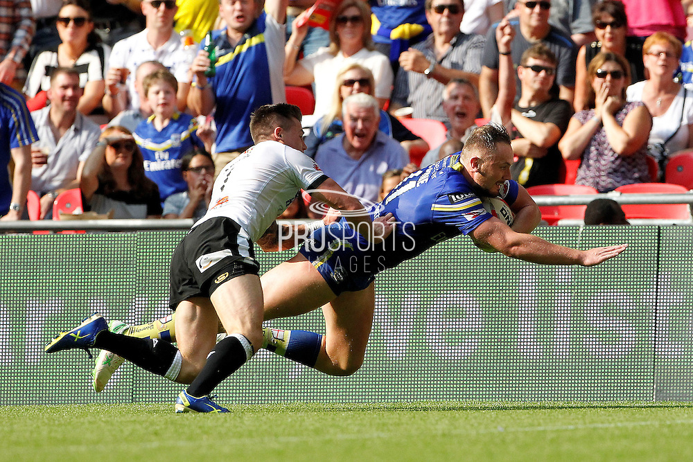 Ben Currie dives over to score Warrington's second try during the Challenge Cup Final 2016 match between Warrington Wolves and Hull FC at Wembley Stadium, London, England on 27 August 2016. Photo by Craig Galloway.