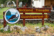 """Nahuel Huapi National Park, Tronador Section sign, Pampa Linda, Argentina, South America. Cerro Tronador is an extinct stratovolcano in the southern Andes, near Bariloche, in the Lake District of Argentina. The sound of falling seracs gave it the name Tronador, Spanish for """"Thunderer."""" With an altitude of 3470 m, Tronador stands more than 1000 meters above nearby mountains in the Andean massif, making it a popular climb. Tronador hosts eight glaciers, which are retreating due to warming of the upper troposphere."""