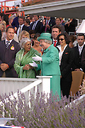 The Queen and Bianca Jagger. Cartier International Day at Guards Polo Club, Windsor Great Park. July 24, 2005. ONE TIME USE ONLY - DO NOT ARCHIVE  © Copyright Photograph by Dafydd Jones 66 Stockwell Park Rd. London SW9 0DA Tel 020 7733 0108 www.dafjones.com