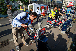 © Licensed to London News Pictures. 09/07/2015. London, UK. Commuters hiring Boris bikes outside Waterloo Station as tube strike shuts down the entire London Underground network on Thursday, July 9, 2015. The strike called by RMT, TSSA and Unite unions is a 27-hour stoppage by about 20,000 Tube staff and shuts down the entire London Underground network. Photo credit: Tolga Akmen/LNP