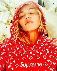 """Madonna releases a photo on Instagram with the following caption: """"\u2665\ufe0f is Supreme \u2665\ufe0f"""". Photo Credit: Instagram *** No USA Distribution *** For Editorial Use Only *** Not to be Published in Books or Photo Books ***  Please note: Fees charged by the agency are for the agency's services only, and do not, nor are they intended to, convey to the user any ownership of Copyright or License in the material. The agency does not claim any ownership including but not limited to Copyright or License in the attached material. By publishing this material you expressly agree to indemnify and to hold the agency and its directors, shareholders and employees harmless from any loss, claims, damages, demands, expenses (including legal fees), or any causes of action or allegation against the agency arising out of or connected in any way with publication of the material."""